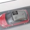Imagen de Opel Adam 1:43, fire red / light grey